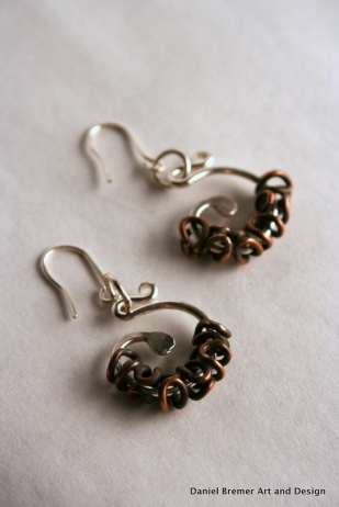 Twist earrings; sterling silver, copper