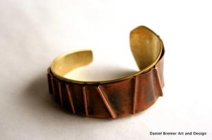 Copper fold cuff; copper, brass, sterling silver