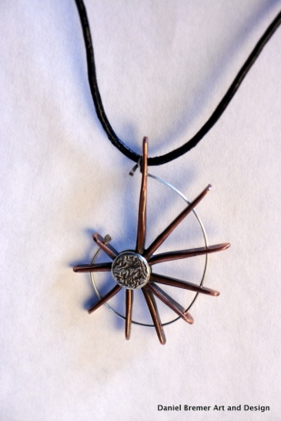 Spoked pendant; copper, sterling silver