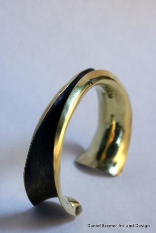 Anticlastic cuff; brass