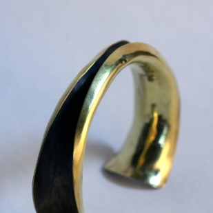 Anticlastic cuff; brass