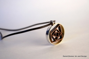 Corners in Circles pendant; sterling silver, copper