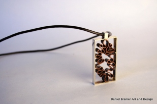 Curves in Squares Pendant; sterling silver, copper