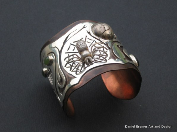 Spider cuff; sterling silver, copper, stones