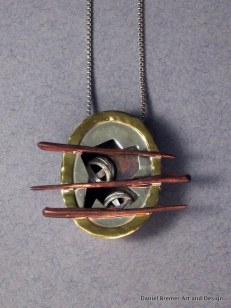 Caged pendant; sterling silver, copper, brass
