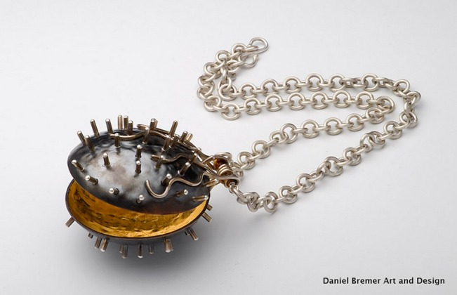 Shell locket; sterling silver, copper, gold leaf Photo credit; Jeremy Addington