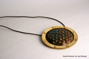 Framed texture pendant; copper, brass, sterling silver