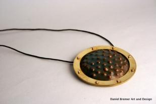 Framed texture pendant; copper, brass, sterling silver