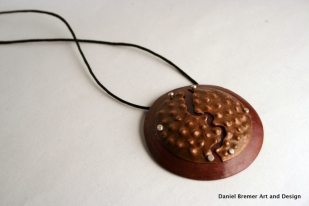 Cracked pendant; copper, sterling silver