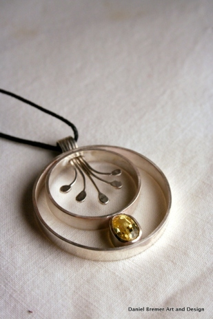 Rooted pendant; sterling silver, yellow sapphire