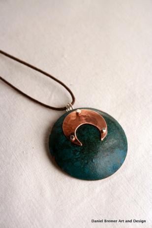 Eclipse pendant; copper, sterling silver
